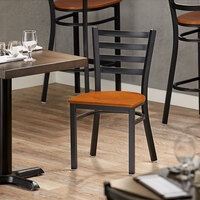 Lancaster Table & Seating Black Finish Metal Ladder Back Cafe Chair with Cherry Wood Seat - Detached Seat