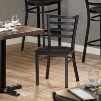 Lancaster Table & Seating Black Finish Metal Ladder Back Cafe Chair with Black Wood Seat - Detached Seat