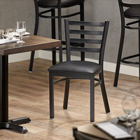Lancaster Table & Seating Black Finish Metal Ladder Back Cafe Chair with Black Padded Seat - Detached Seat