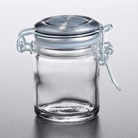 Tablecraft 10105 1.5 oz. Glass Condiment Jar with Stainless Steel Lid and Bail and Trigger Closure