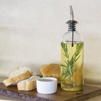 Tablecraft 10375 18 oz. Clear Glass Oil and Vinegar Bottle with Stainless Steel Pourer