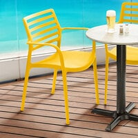Lancaster Table & Seating Allegro Yellow Stackable Resin Arm Chair