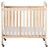 Foundations 2532040 Serenity 24 inch x 38 inch Natural Compact Fixed-Side Clearview Wood Crib with Adjustable Mattress Board and 3 inch InfaPure Mattress
