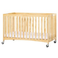 Foundations 2711047 Travel Sleeper 28 inch x 52 inch Natural Full Size Slatted Wood Folding Crib with Oversized Casters and 3 inch InfaPure Mattress