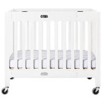 Foundations 2131120 Boutique 24 inch x 38 inch Matte White Compact Slatted Wood Folding Crib with Oversized Casters and 3 inch InfaPure Mattress