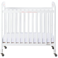Foundations 2532120 Serenity 24 inch x 38 inch White Compact Fixed-Side Clearview Wood Crib with Adjustable Mattress Board and 3 inch InfaPure Mattress