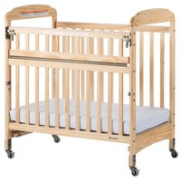 Foundations 2542040 Serenity SafeReach 24 inch x 38 inch Natural Compact Clearview Wood Crib with Safety Access Gate, Adjustable Mattress Board, and 3 inch InfaPure Mattress