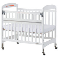 Foundations 2542120 Serenity SafeReach 24 inch x 38 inch White Compact Clearview Wood Crib with Safety Access Gate, Adjustable Mattress Board, and 3 inch InfaPure Mattress