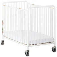 Foundations 2031097 Chelsea 24 inch x 38 inch White Compact Powder-Coated Steel Crib with Slatted End Panel, Oversized Casters, and 3 inch InfaPure Mattress