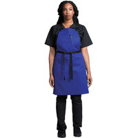 Uncommon Threads 3128 Deep Royal Customizable Poly-Cotton Surge Bib Apron with Black Webbing and 3 Pockets - 34 inchL x 23 inchW