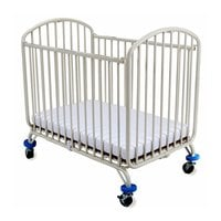 L.A. Baby CS-72 24 inch x 38 inch White Folding Metal Arch Crib with 3 inch Fire Retardant Mattress