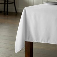 Intedge 54 inch x 120 inch Rectangular White 100% Polyester Hemmed Cloth Table Cover