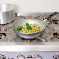 Vollrath 59949 11 inch Carbon Steel Stir Fry Pan with TriVent Silicone Handle