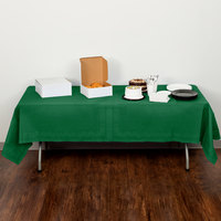Creative Converting 710201B 54 inch x 108 inch Emerald Green Tissue / Poly Table Cover - 24/Case