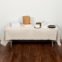Creative Converting 710207B 54 inch x 108 inch Ivory Tissue / Poly Table Cover - 24/Case