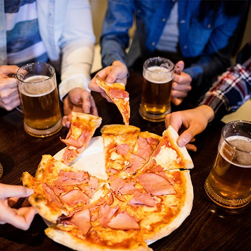 Friends drinking beer with pizza